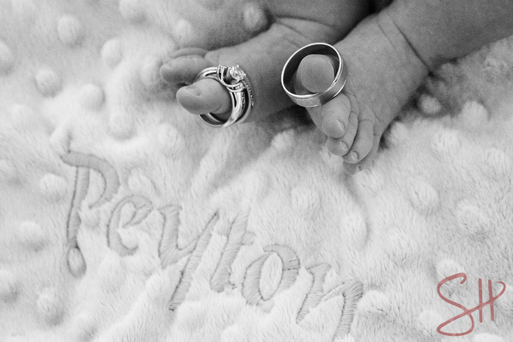 Baby's toes with parents' rings
