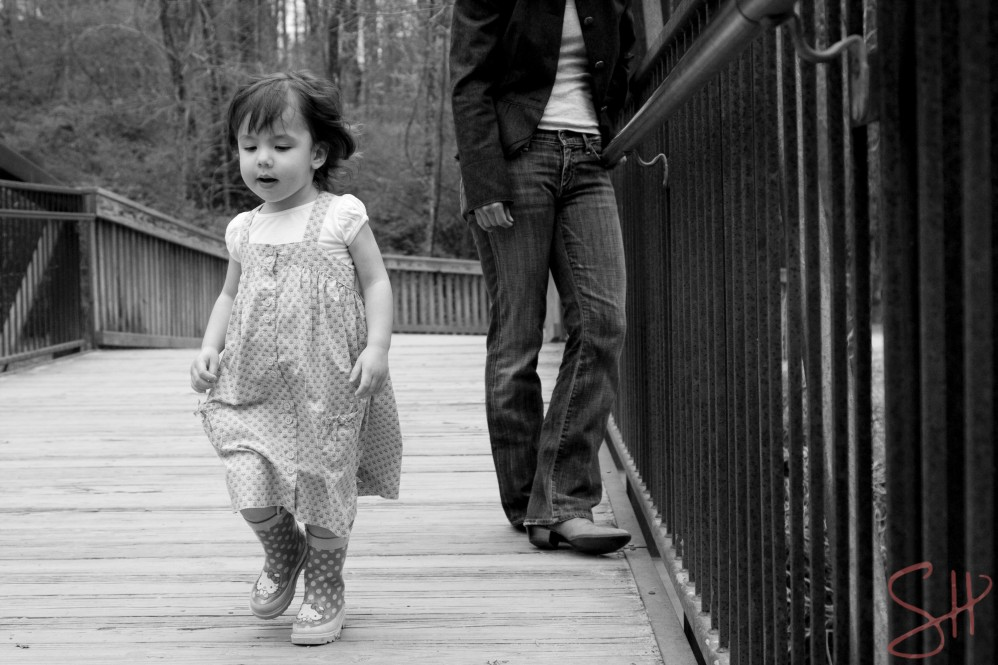 Little girl walking with her mom