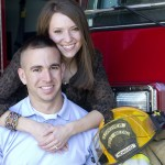 Engaged couple with his fire helmet